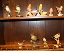 TWO SHELVES CONTAINING A SELECTION OF MODEL BIRDS, to include Royal Worcester examples and Country