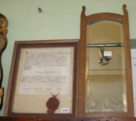 A SMALL BEVEL PLATE WOODEN FRAMED WALL MIRROR, together with a glazed and framed Religious document