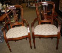 A PAIR OF MODERN ARMCHAIRS with overstuffed seat pads
