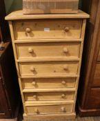 A STRIPPED PINE TALL CHEST OF SIX DRAWERS