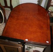 A REPRODUCTION POLLARD YEW WOOD COLOURED OVAL TWIN FLAP TOPPED TABLE