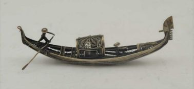 AN EARLY 20TH CENTURY ITALIAN WHITE METAL MODEL OF A GONDOLA, with hinged compartment, 15cm long
