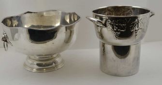 A SILVER PLATE ON COPPER PUNCH BOWL, fitted two lion mask ring handles, 33cm in diameter, together