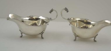ADIE BROTHERS. LTD A PAIR OF SILVER SAUCE BOATS OF GEORGIAN DESIGN, with cast Celtic form mask