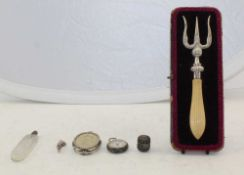 A LATE VICTORIAN SILVER MOUNTED BREAD FORK, together with; a sterling thimble case with ring