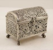 A DUTCH SILVER TABLE CASKET, domed hinged cover, cast, pierced design with birds and flowers, a mask