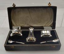 J.W. TIPTAFT & SON LTD. AN ART DECO SILVER CONDIMENT SET, comprising; mustard pot, pepper pot,