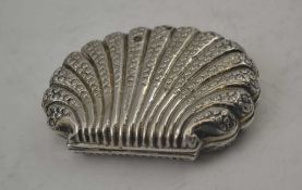 A LATE 19TH CENTURY CONTINENTAL WHITE METAL SCALLOP FORM PURSE with embossed decoration, pink fabric