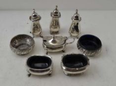 A PAIR OF EDWARDIAN CIRCULAR SILVER SALTS, with repousse rims, Sheffield 1905, together with various