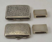 TWO ENGRAVED SILVER CIGARETTE CASES Birmingham 1916 & Birmingham 1929, with gilded interiors,