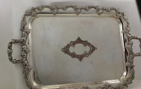AN EARLY 20TH CENTURY SILVER PLATE ON COPPER TWO-HANDLED TEA TRAY, with cast fruiting vine rim and