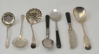 A SILVER SUGAR SCOOP, Newcastle 1843, three sifting spoons London 1881, London 1906, Birmingham