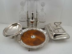 A SELECTION OF SILVER PLATED WARES, to include; an oak base salver with plated pie-crust rim on claw