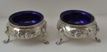 A PAIR OF VICTORIAN SILVER SALTS, London 1876, floral decoration, with blue glass liners, combined