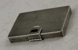 COHEN & CHARLES An Art Deco silver rectangular box, engine turned decoration, gilded interior, 8cm x