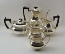 WILLIAM WILLIAMS LTD A LATE VICTORIAN FIVE PIECE SILVER TEA & COFFEE SET of Georgian design,