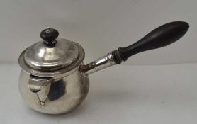 THOMAS RADCLIFFE A George III silver covered pan, with turned ebony side handle, London 1810,