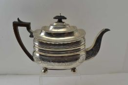 JOHN DOUGLAS A George III silver teapot, waisted rectangular form, floral chased decoration, on ball
