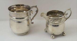 AN ART NOUVEAU SILVER CREAM JUG Birmingham 1903 together with a silver Christening mug, Birmingham