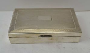 A 20TH CENTURY SILVER CIGARETTE BOX, engine turned hinged cover, cedar lined, Birmingham 1964,