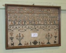 A 19TH CENTURY NEEDLEWORK SAMPLER with alphabet above a band of stylised animals and plants, 22cm