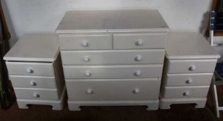 A THREE-PIECE BEDROOM SUITE comprising a pair of bedside units and a small sized five drawer chest
