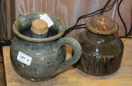 A HOWARD BISSELL STUDIO POTTERY JAR, incised decoration, mottled green/brown glaze. 13cm high