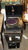 TWO BLACK FINISHED METAL DEED BOXES together with a cased Commonwealth branded wind-up GRAMOPHONE
