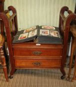 A FIRST QUARTER 20TH CENTURY MAHOGANY CONVERTED CANTERBURY, now formed as a music stool, with two