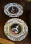 A PAIR OF CONTINENTAL CERAMIC CABINET PLATES, each with a central painted musician within a floral