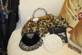 A SELECTION OF LADY'S CLUTCH & HANDBAGS