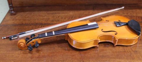 A CHILD SIZE VIOLIN and bow