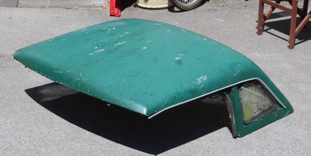 A VINTAGE GREEN FINISHED MG HARD TOP COVER