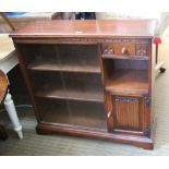 AN OLD CHARM BRANDED OAK SIDE UNIT with twin sliding glazed doors, having carved front single