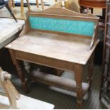 AN EARLY 20TH CENTURY PINE FRAMED WASHSTAND having turquoise tiled splash back, a rectangular top on