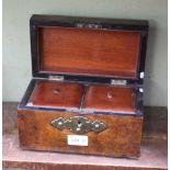 A 19TH CENTURY WALNUT TEA CADDY with decorative brasswork panels
