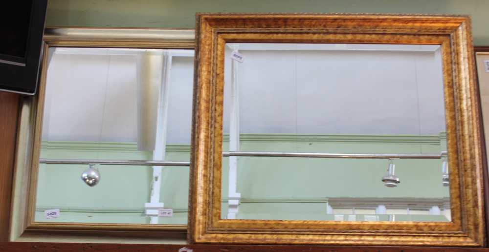 TWO GILT FRAMED BEVELLED PLATE WALL MIRRORS
