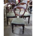 THREE VICTORIAN MAHOGANY BALLOON BACK CHAIRS with upholstered seat pads