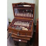 A WELL FITTED OAK CANTEEN OF CUTLERY containing an extensive selection of cutlery from William