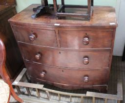 A 19TH CENTURY SMALL SIZED MAHOGANY FINISHED BOW FRONT CHEST OF FOUR DRAWERS
