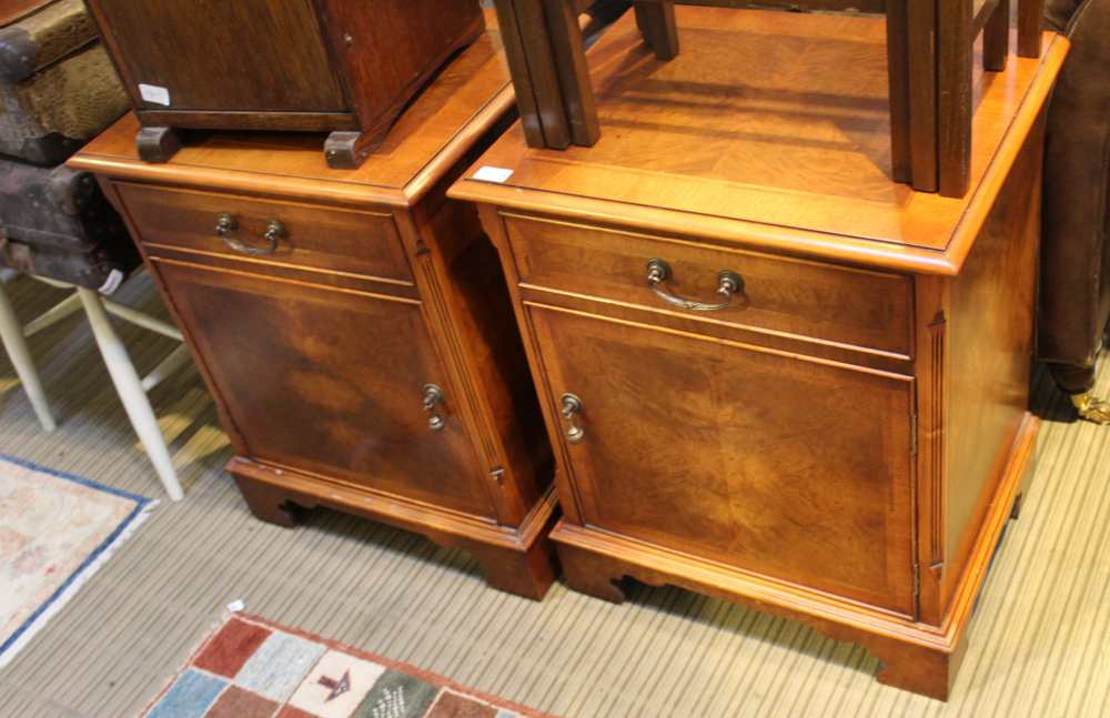 A PAIR OF REPRODUCTION BEDSIDE CABINETS by Paul Smith furniture, retailed through Brights of