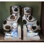 A PAIR OF 19TH CENTURY GREEN LUSTRE DECORATED HEARTH SPANIELS together with a pair of onyx