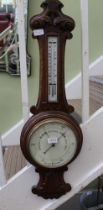A 19TH CENTURY OAK BACKED BAROMETER THERMOMETER