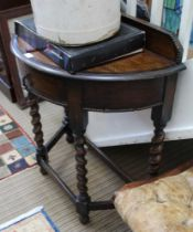A FIRST QUARTER 20TH CENTURY OAK FINISHED DEMI-LUNE SIDE TABLE with beaded upstand, single central