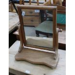 A 19TH CENTURY PINE FRAMED ADJUSTABLE PLAIN PLATE DRESSING TABLE TOP MIRROR on shaped plank plinth