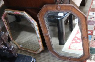 A MID-20TH CENTURY OAK BEADED FRAMED BEVEL PLATE WALL MIRROR sold together with a modern wall mirror