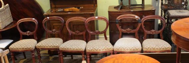 A SET OF SIX MAHOGANY FINISHED BALLOON BACK CHAIRS with upholstered serpentine fronted seat pads