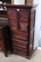 AN IMPORTED MAHOGANY COLOURED WOODEN FREESTANDING CHEST OF DRAWERS with plain ring drop handles