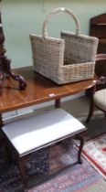 A WOVEN WICKERWORK LOG CADDY sold together with a pad topped four legged stool