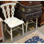 A PAIR OF LATER PAINTED ERCOL SOLID SEATED CHAIRS with fleur-de-lys slat backs